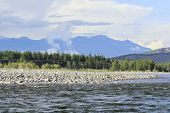 stock photo of raft  - Siberian the Oka river takes its rise among the mountains of Tien Shan and interesting for rafting and fishing  - JPG