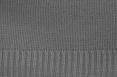 stock photo of knitting  - close up of a gray knitted background pattern - JPG