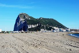 picture of gibraltar  - Rock of Gibraltar to the rear seen from La Linea beach in Spain Gibraltar United Kingdom Western Europe - JPG