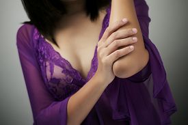foto of elbow  - Adult woman with elbow pain - JPG