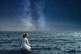 picture of under sea  - serenity and yoga practicing at the sea under night sky - JPG