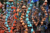 stock photo of windchime  - South Indian pottery at a market stall in Kerala - JPG