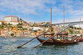 image of old boat  - Porto and old traditional boats with wine barrels in Portugal in a summer day - JPG