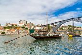 pic of old boat  - Porto and old traditional boats with wine barrels in Portugal in a summer day - JPG