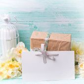 pic of text-box  - Narcissus flowers empty tag for text candle box with present on turquoise painted wooden planks - JPG