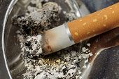 foto of ashes  - Cigarette and ashes in a metal ashtray macro - JPG