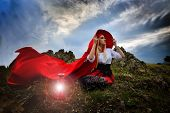pic of cloak  - beautiful woman with red cloak in the sunset light - JPG