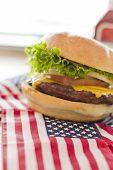 image of patriot  - Patriotic American flag cheeseburger for American patriotism celebration food image  - JPG