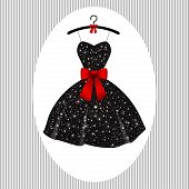 stock photo of little black dress  - little black dress with a red bow on a hanger - JPG