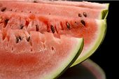 picture of watermelon slices  - Macro shot of slices of watermelon on black background - JPG