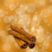 pic of cinnamon sticks  - Fragrant cinnamon sticks isolated on the bokeh background - JPG