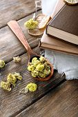 foto of roughage  - Old books with dry flowers and lemon on table close up - JPG