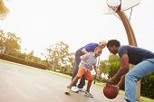 foto of grandfather  - Grandfather With Son And Grandson Playing Basketball - JPG