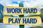 image of hard-on  - Work Hard Play Hard sign with mountains background - JPG