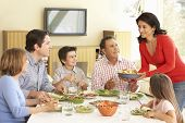 stock photo of extend  - Extended Hispanic Family Enjoying Meal At Home - JPG