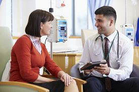 picture of chemotherapy  - Woman Having Chemotherapy With Doctor Using Digital Tablet - JPG