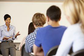 foto of teachers  - African American teacher teaching at front of class - JPG
