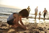 stock photo of summer beach  - Kid on beach in sand playing - JPG