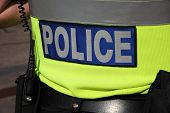 stock photo of bobbies  - Silver on blue Police  worn by British bobby on body armour - JPG