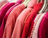 picture of thrift store  - pink clothes on a rack in thrift store - JPG