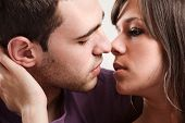 stock photo of kissing couple  - young couple in love - JPG