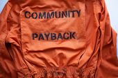 Community Payback. Close Up. Prison Clothes, Jumpsuit Sentenced To Correctional Labor, Criminal Pena poster