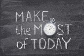 Make The Most Of Today Phrase Handwritten On Chalkboard With Vintage Precise Stopwatch Used Instead  poster