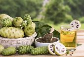 Noni Fruit Juice Or Morinda Citrifolia With Noni Slice And Noni Powder For Health On The Wooden Back poster