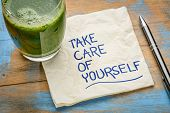 take care of yourself - inspirational handwriting on a napkin with a glass of green juice poster