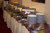 stock photo of chafing  - chafing dish prepared for arrival of visitors for maintenance of hot temperature of the roasted dishes of meal - JPG