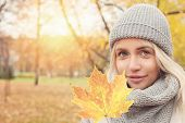 Autumn Woman With Yellow Maple Leaf Outdoors. Romantic Girl In Fall Park poster