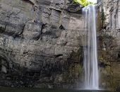 stock photo of shale  - This waterfall has carved away over one mile of shale rock in the Finger lakes Region area - JPG