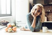 Young Smiling Woman Next To Bowl Of Fresh Fruits. Portrait Of Young Beautiful Girl Next To Bowl Fill poster