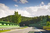 picture of noise pollution  - Highway and green forest in the summertime - JPG