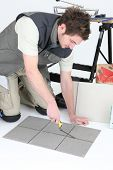 stock photo of grout  - Tiler grouting - JPG