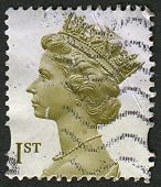 UK-CIRCA 2000:A stamp printed in UK shows image of Elizabeth II is the constitutional monarch of 16