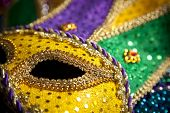 picture of mardi-gras  - A group of mardi gras beads an mask with copy space - JPG