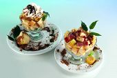 Fruit salad in a sundae dish on a blue background
