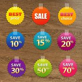 foto of status  - Big Colorful Sale Tags With Wooden Background - JPG