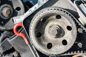 stock photo of pulley  - Camshaft pulley is shown in the example of the old damaged engine - JPG