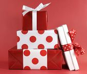 image of christmas theme  - Stack of red and white polka dot theme festive gift box presents for Christmas Valentine birthday or Mothers Day occasion - JPG