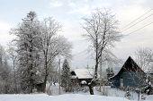 stock photo of zakarpattia  - Beautiful winter evening in snowy Ukrainian village - JPG