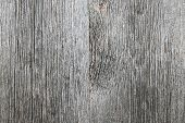 stock photo of woodgrain  - Weathered distressed rustic barn wood as textured background - JPG