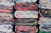 stock photo of loincloth  - Loincloth beautiful colorful stacked vertically - JPG
