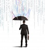 image of antivirus  - Antivirus and firewall concept with businessman protected with umbrella - JPG
