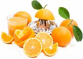 stock photo of juicer  - Glass filled with fresh made orange juice juicer and fruits - JPG