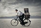 stock photo of fatigue  - riding his bike - JPG
