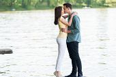 foto of pier a lake  - Joyful and spontaneous couple in love - JPG