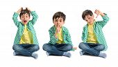 stock photo of shh  - Kid doing silence gesture bad sign and shouting - JPG