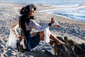 image of pirate hat  - Portrait of a pirate woman at the beach - JPG